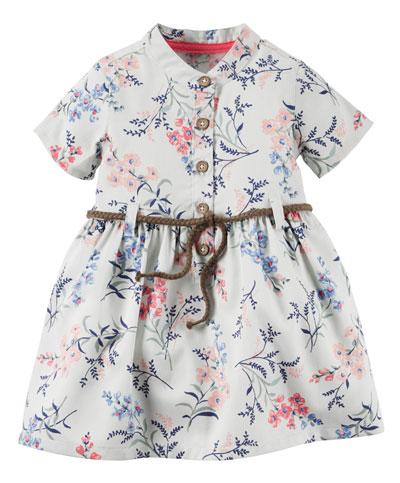 שמלה לבנה עם דפוסי פרחים וכפתורים. קרטר'ס (צילום: טל טרי(